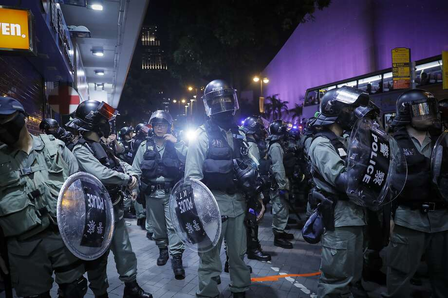 An app that tracks movement of riot police like these in Hong Kong was dropped from the App Store there. Photo: Kin Cheung / Associated Press