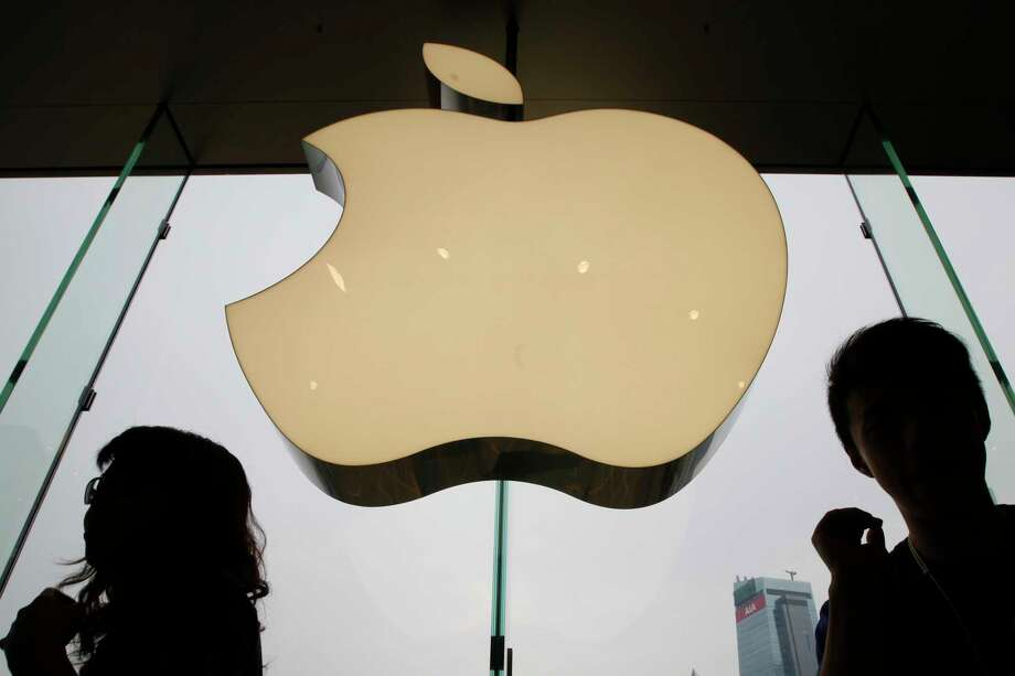 In this Sept. 24, 2011, photo, an Apple logo is displayed at the Apple store in International Financial Center (IFC) shopping Mall, in Hong Kong. Apple became the latest company targeted for Chinese pressure over protests in Hong Kong when the ruling Communist Party's main newspaper criticized the tech giant Wednesday for a smartphone app that allows activists to report police movements. (AP Photo/Kin Cheung) Photo: Kin Cheung / Copyright 2018 The Associated Press. All rights reserved
