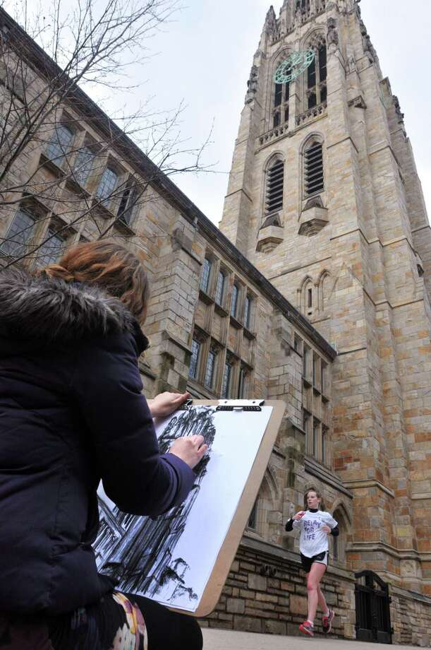 Marisa Kaugaris, a former Yale student, works on a drawing of Harkness Tower early Thursday afternoon. Photo: Peter Casolino /