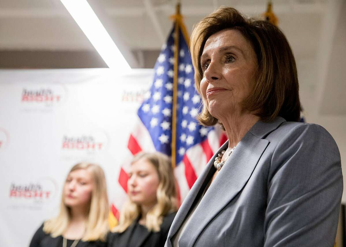 House Speaker Nancy Pelosi listens during a press conference held to highlight efforts Democrats are making to preserve coverage of pre-existing conditions and lower medical and drug costs at HealthRight 360 in San Francisco, Calif. Saturday, June 15, 2019.