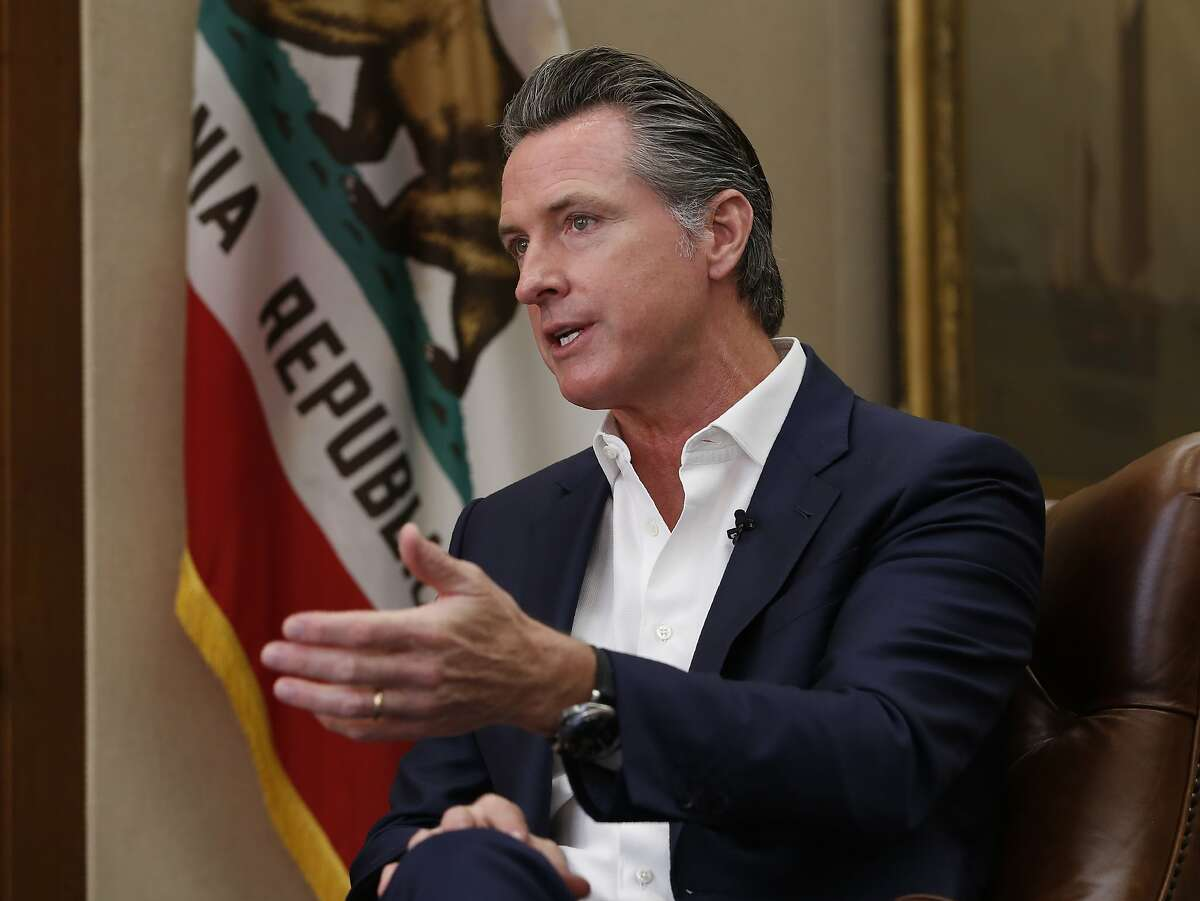 """Calling President Donald Trump """"completely corrupt"""" California Gov. Gavin Newsom said Trump should be removed from office by Congress, during an interview in Sacramento, Calif., Tuesday, Oct. 8, 2019. But Newsom said that with Republicans in control of the U.S. Senate the best way to boot Trump from office is at the ballot box. (AP Photo/Rich Pedroncelli)"""