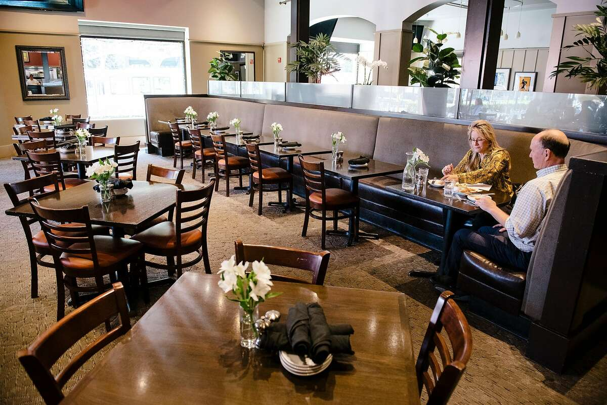 Greg Richardson and Teresa Anthony of nearby Gel Company have the dining room almost entirely to themselves during a lunch meeting at Momo's restaurant in San Francisco, California, on Friday, Oct. 4, 2019.