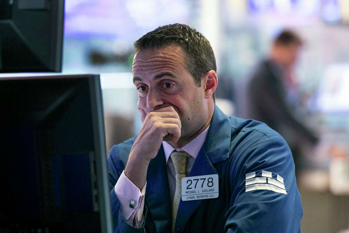 FILE - In this Oct. 2, 2019, file photo specialist Michael Gagliano works at his post on the floor of the New York Stock Exchange. The U.S. stock market opens at 9:30 a.m. EDT on Thursday, Oct. 10. (AP Photo/Richard Drew)