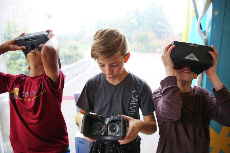 Fifth graders at Briarwood Elementary get to explore the Curiosity Cube, a hands-on, mobile science lab, that visited the school on Monday, Oct. 7, 2019.  The lab, operated by MilliporeSigma, uses technology like VR, AR and 3D printers to teach students across the country about science in an interactive way. Photo: Genna Martin, Seattlepi.com / GENNA MARTIN