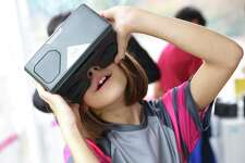 Fifth graders at Briarwood Elementary learn about the human body through VR goggle as they explore the Curiosity Cube, a hands-on, mobile science lab, that visited the school on Monday, Oct. 7, 2019. The lab, operated by MilliporeSigma, uses technology like VR, AR and 3D printers to teach students across the country about science in an interactive way.