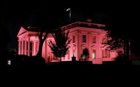 The White House is illuminated pink in Washington, Tuesday, Oct. 1 2019, in honor of Breast Cancer Awareness Month.