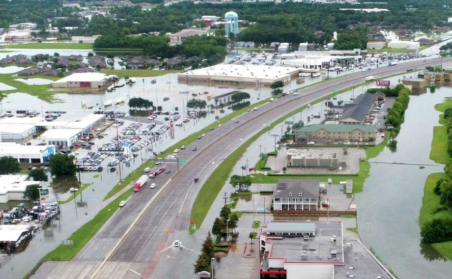 Flood waters from Tropical Depression Imelda can be seen surrounding Sam's Club and several businesses along Interstate 10 on Thursday, September 19, 2019 Photo: Guiseppe Barranco/The Enterprise, Photo Editor / Guiseppe Barranco ©