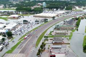Flood waters from Tropical Depression Imelda can be seen surrounding Sam's Club and several businesses along Interstate 10 on Thursday, September 19, 2019