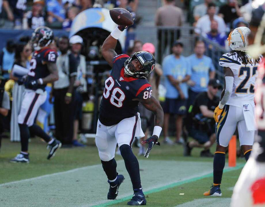 Houston Texans tight end Jordan Akins (88) spikes the ball after scoring on a 15-yard touchdown reception against the Los Angeles Chargers during the third quarter of an NFL football game at Dignity Health Sports Park on Sunday, Sept. 22, 2019, in Carson, Calif. Photo: Brett Coomer, Houston Chronicle / Staff Photographer / © 2019 Houston Chronicle