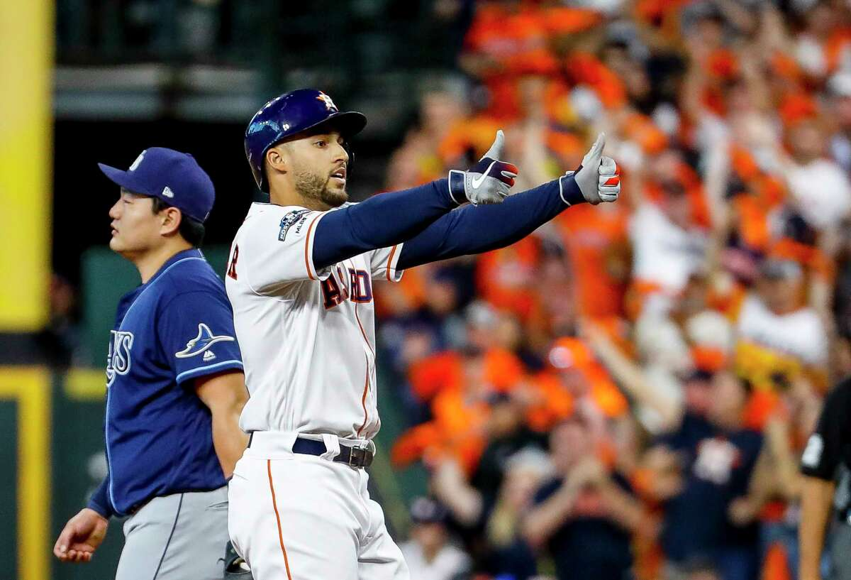 Houston Astros center fielder George Springer (4) celebrates his leadoff single in the first inning of Game 5 of the American League Division Series at Minute Maid Park in Houston, on Thursday, Oct. 10, 2019.