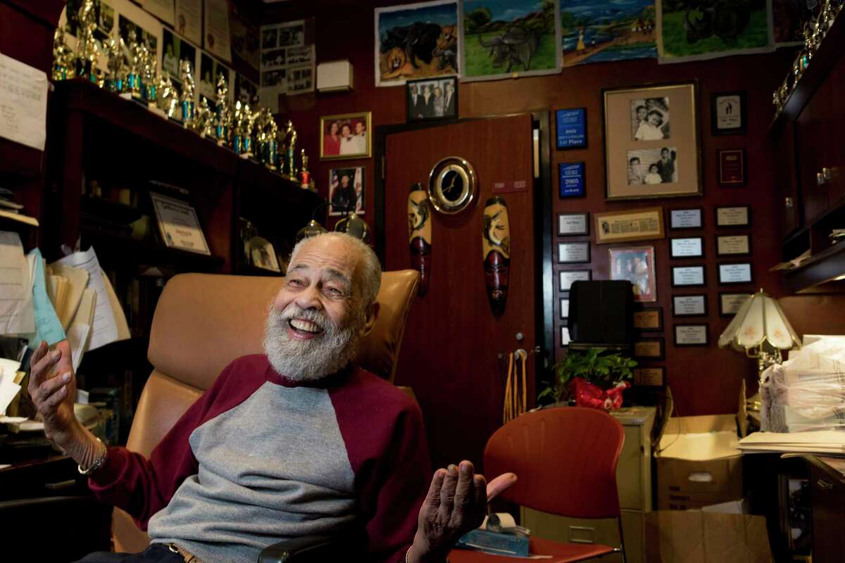 Dr. Thomas Freeman, founding dean of the Texas Southern University Honors College and longtime debate team director, laughs while working in his office on Wednesday, June 19, 2019, in Houston. Freeman has worked at the university for the past 70 years and has led the debate team to dozens of championships.