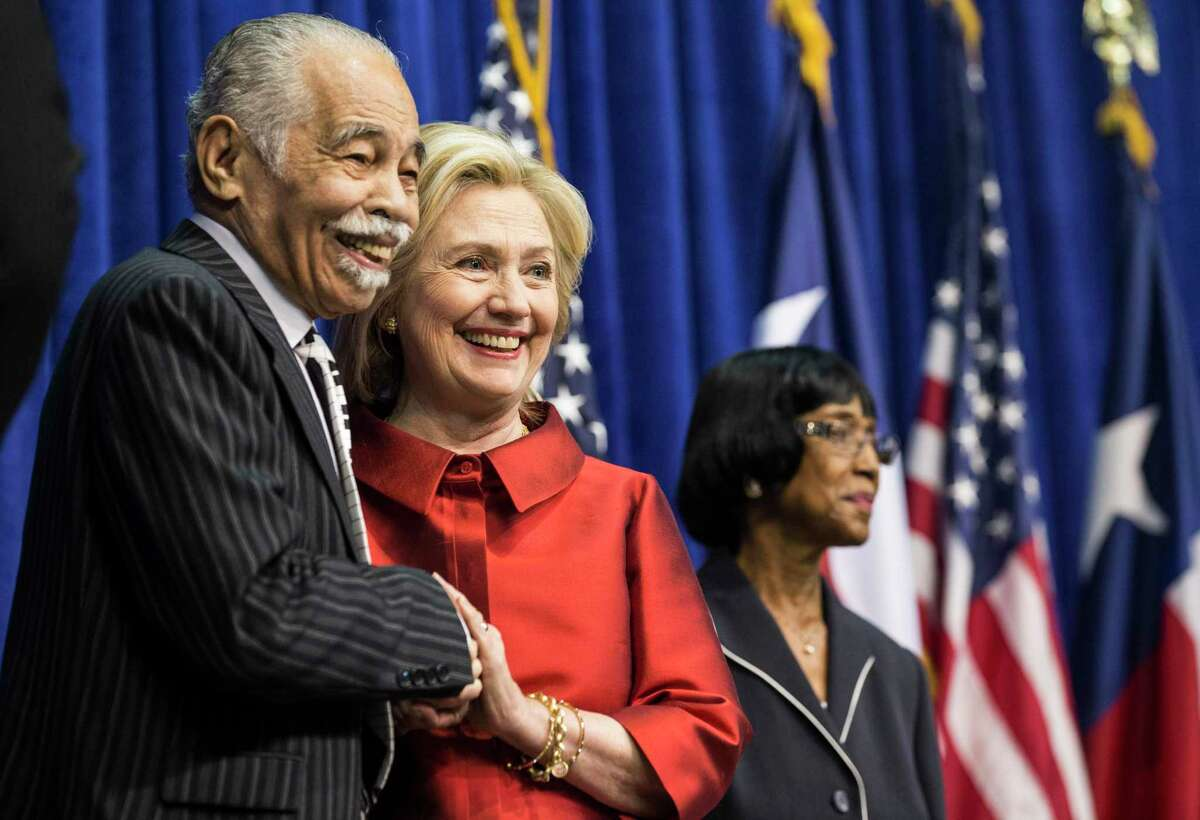Former Secretary of State Hillary Rodham Clinton stands with Dr. Thomas Freeman before she was presented the Inaugural Barbara Jordan Gold Medallion Leadership Award on the campus of Texas Southern University on Thursday, June 4, 2015, in Houston.
