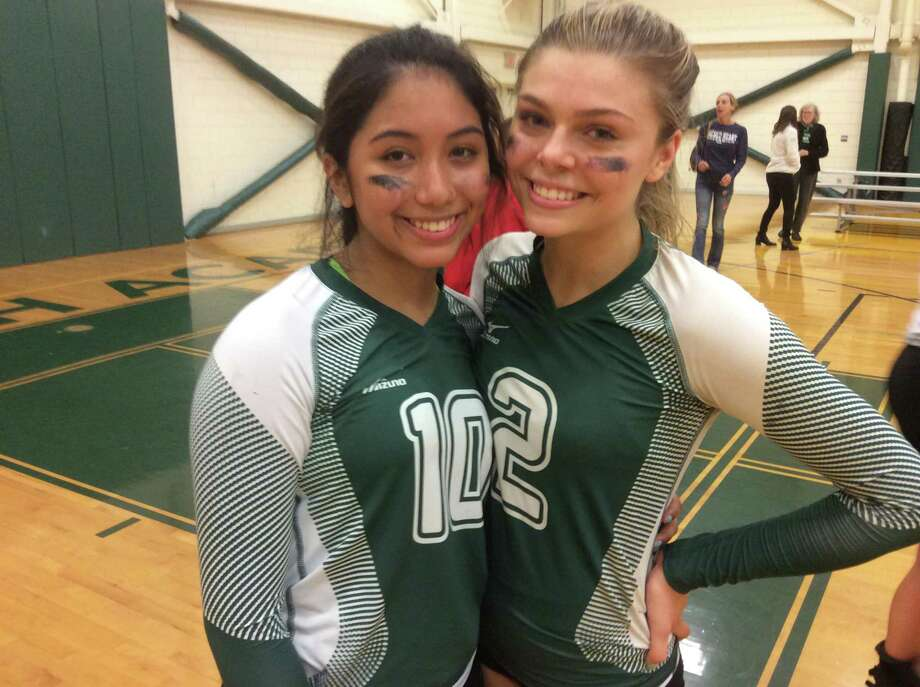From left to right, Sacred Heart Greenwich volleyball captains Salome Alfaro and Kellie Ulmer helped the team edge rival Greenwich Academy, 3-2, in an FAA match held on Thursday, Oct. 10, 2019, in Greenwich. Photo: David Fierro /Hearst Connecticut Media