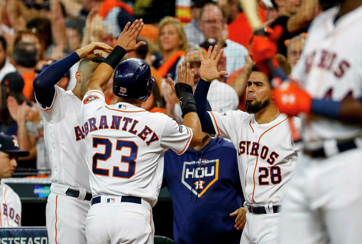 PHOTOS: Action from Game 5 of the Astros-Rays ALDS Houston Astros left fielder Michael Brantley (23) is welcomed back to the dugout after scoring on a double by Alex Bregman during the first inning of Game 5 of the American League Division Series at Minute Maid Park in Houston, on Thursday, Oct. 10, 2019.