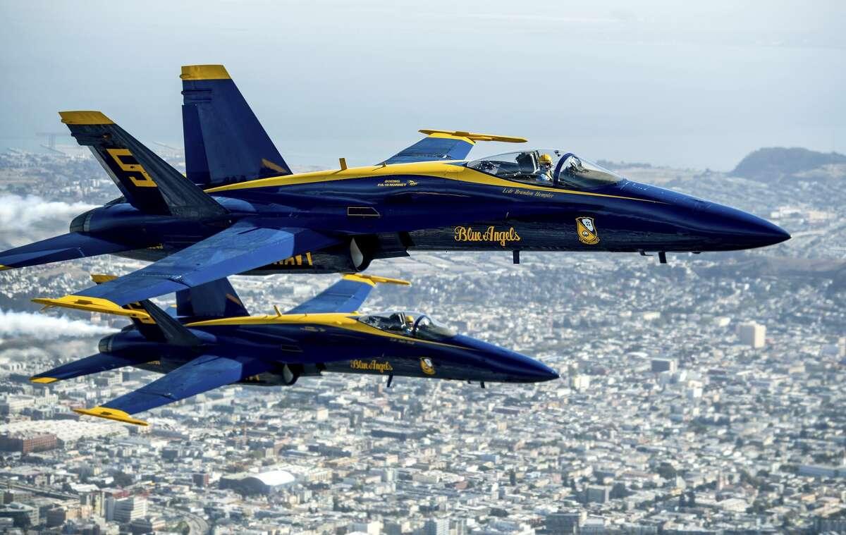 In advance of Fleet Week performances, U.S. Navy Blue Angels fly over San Francisco on Thursday, Oct. 10, 2019. (AP Photo/Noah Berger)