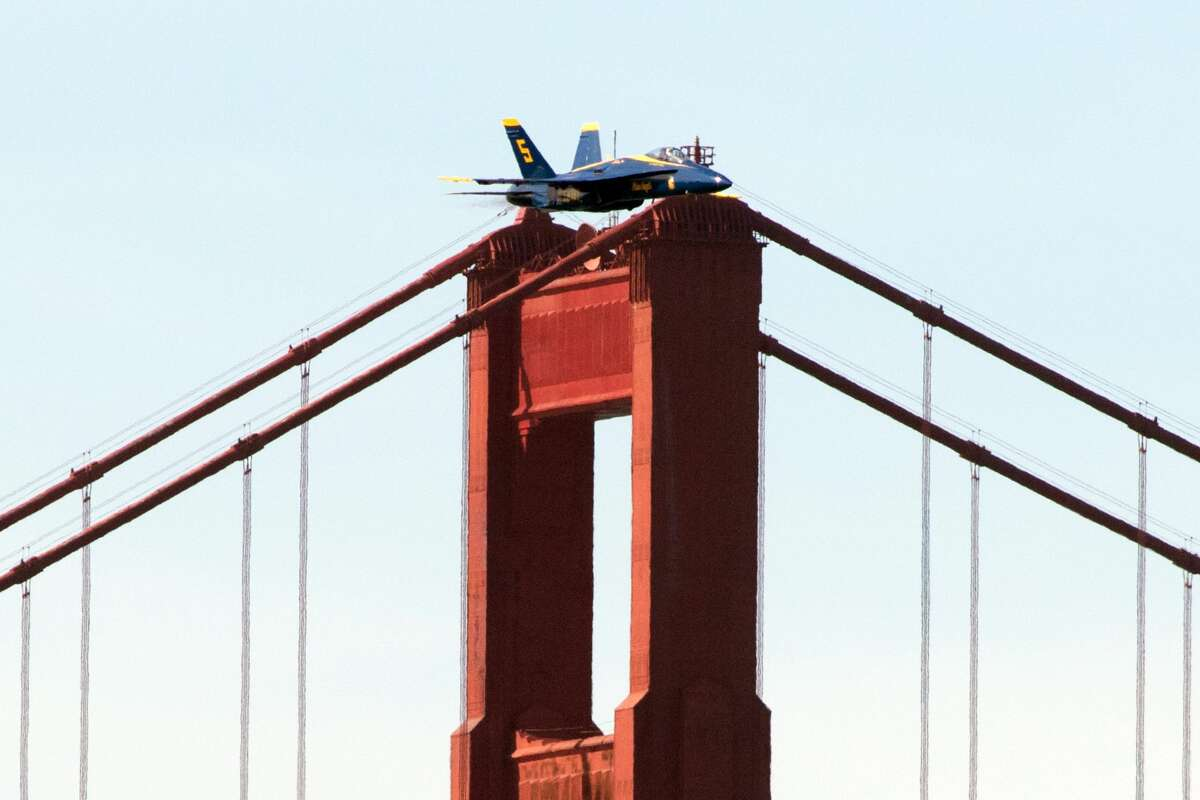 One of the Blue Angels planes appears to be balanced on top of one of the Golden Gate Bridge towers. The flying squadron was practicing for their SF Fleet Week performance over the San Francisco Bay Area on October 10, 2019.
