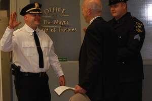 The new Scotia village police chief, Daniel Harrigan, takes the oath.
