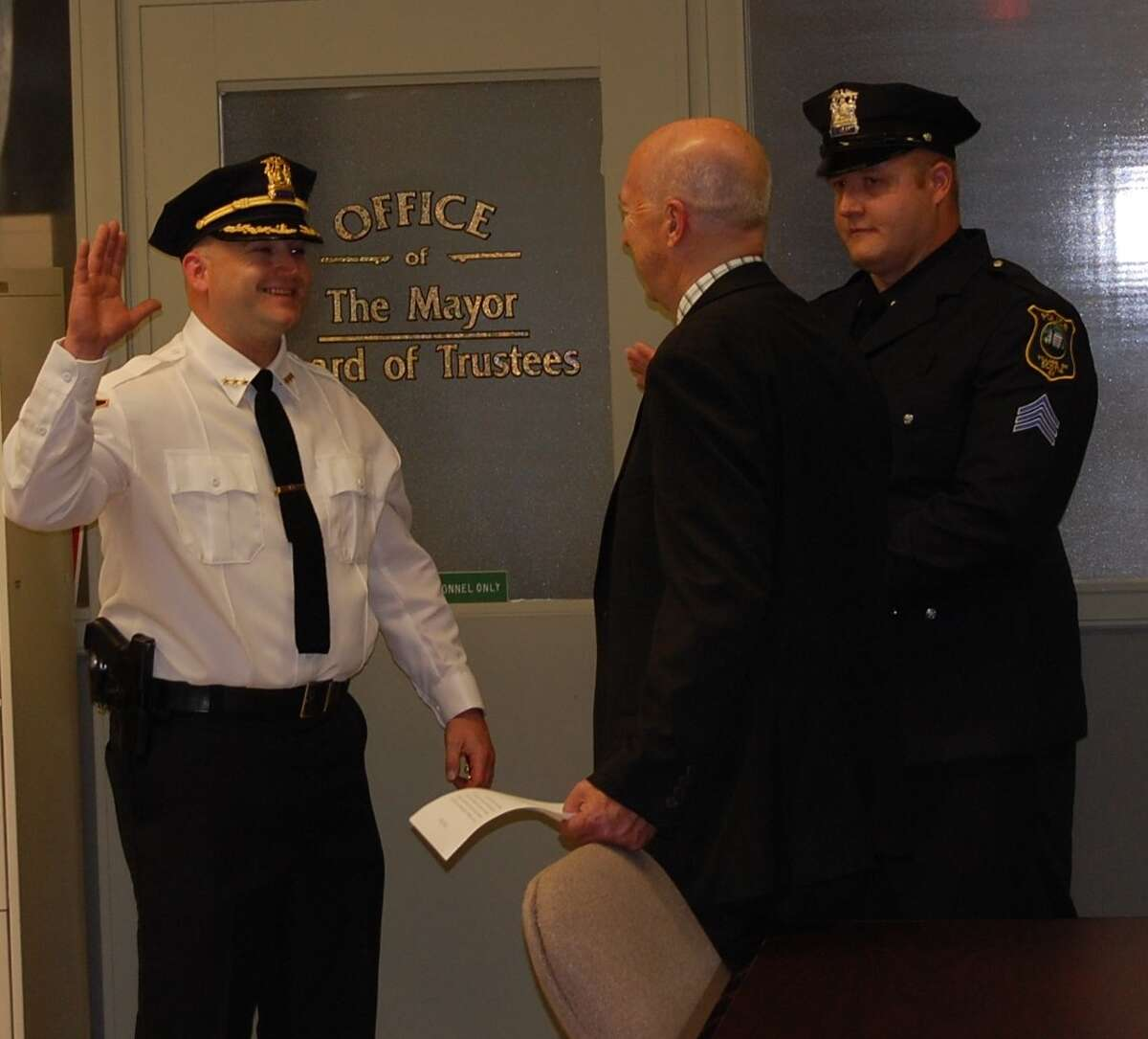 The new Scotia village police chief, Daniel Harrigan, takes the oath.