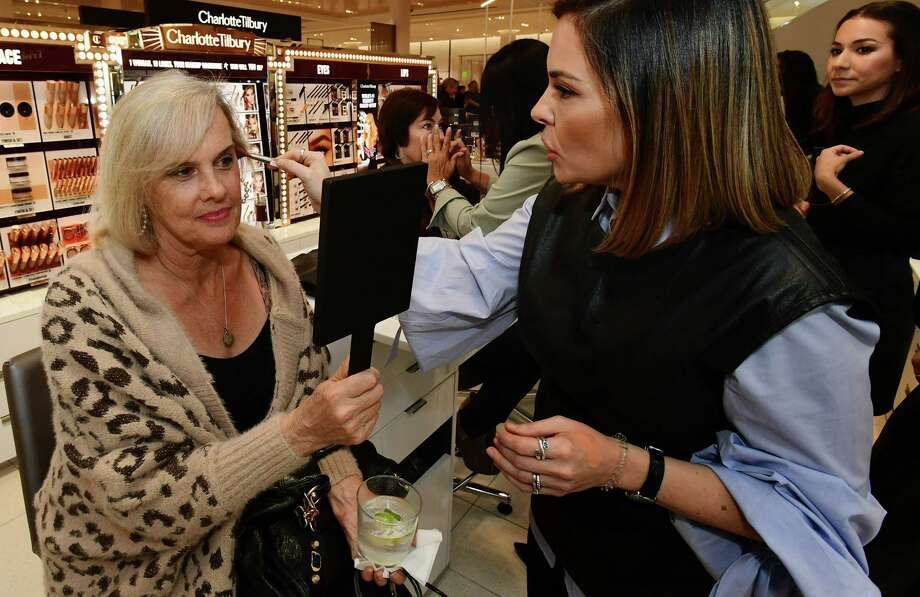 Norwalk resident Pat Brown gets her makeup done by Erica Mrose during Nordstrom's Night Out benefit for two Fairfield County charities in the new SoNo Collection mall Thursday, October 10, 2019, in Norwalk, Conn. Photo: Erik Trautmann / Hearst Connecticut Media / Norwalk Hour