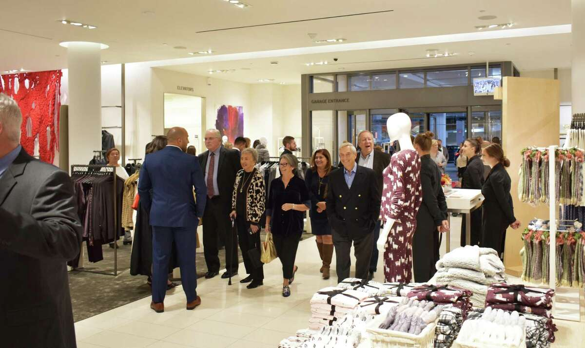 """Visitors arrive for the """"Nordstrom Night Out"""" benefit at the SoNo Collection mall on Thursday, Oct. 10, 2019, in Norwalk, Conn."""