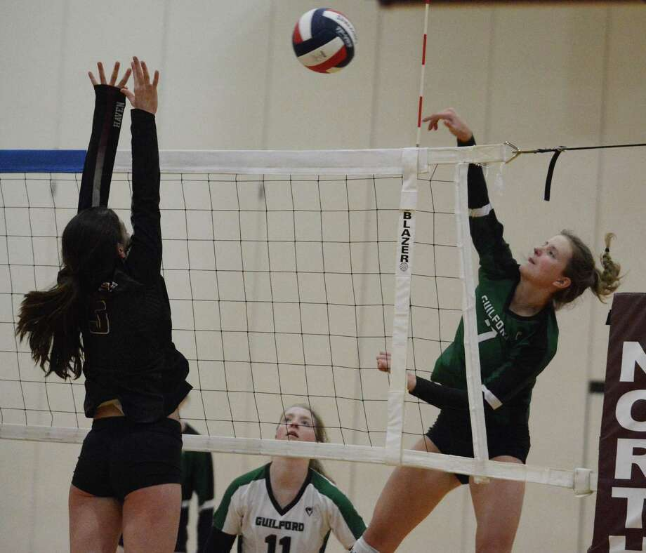 Guilford'' Emma Appleman goes up for a kill against North Haven on Thursday. Photo: Dave Phillips / For Hearst Connecticut Media