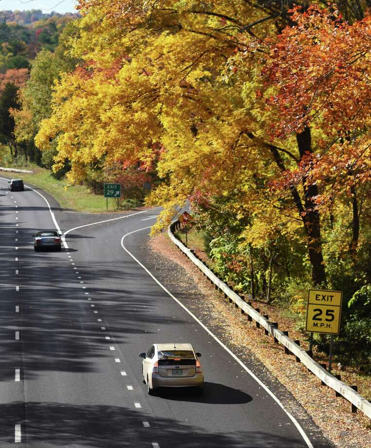 Traffic passes underneath yellow and orange foliage by the Lake Avenue exit along the Merritt Parkway in Greenwich, Conn. in this Oct. 30, 2014, file photo. Photo: Hearst Connecticut Media / Tyler Sizemore / Greenwich Time