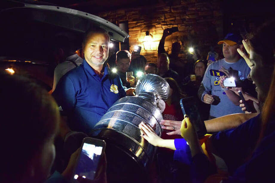 The Stanley Cup made a special visit to the metro-east on Wednesday, including Edwardsville at Mike Shannon's Grill. Members of the community and Edwardsville High School ice hockey team came out to celebrate and take their picture with the cup. Photo: Tyler Pletsch | The Intelligencer