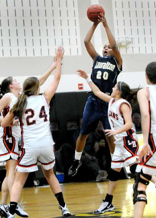 Keylantra Langley shoots over the Lyman Hall defense. Langley scored 27 points in Lauralton Hall's 65-42 victory in the Hand Holiday Tournament championship game. (Photo by Melanie Stengel/ New Haven Register)