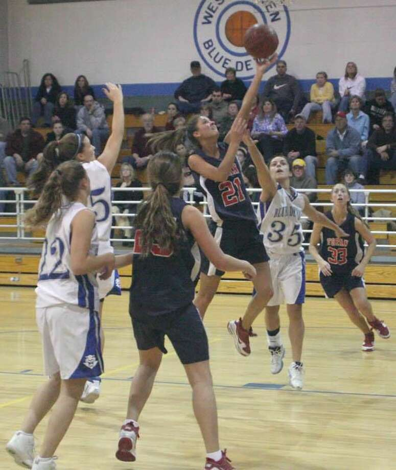 Foran's Annie Raucci drives to the basket against West Haven. (Photo by Russ McCreven)