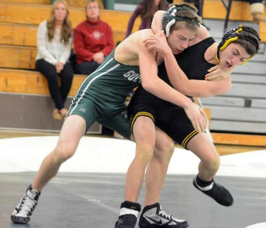 Photo by Dave Phillips Guilford's Andrew Ignato and Amity's Jake Cala tangle during their 120-pound match Wednesday night. Ignato won by pin in 5:46.