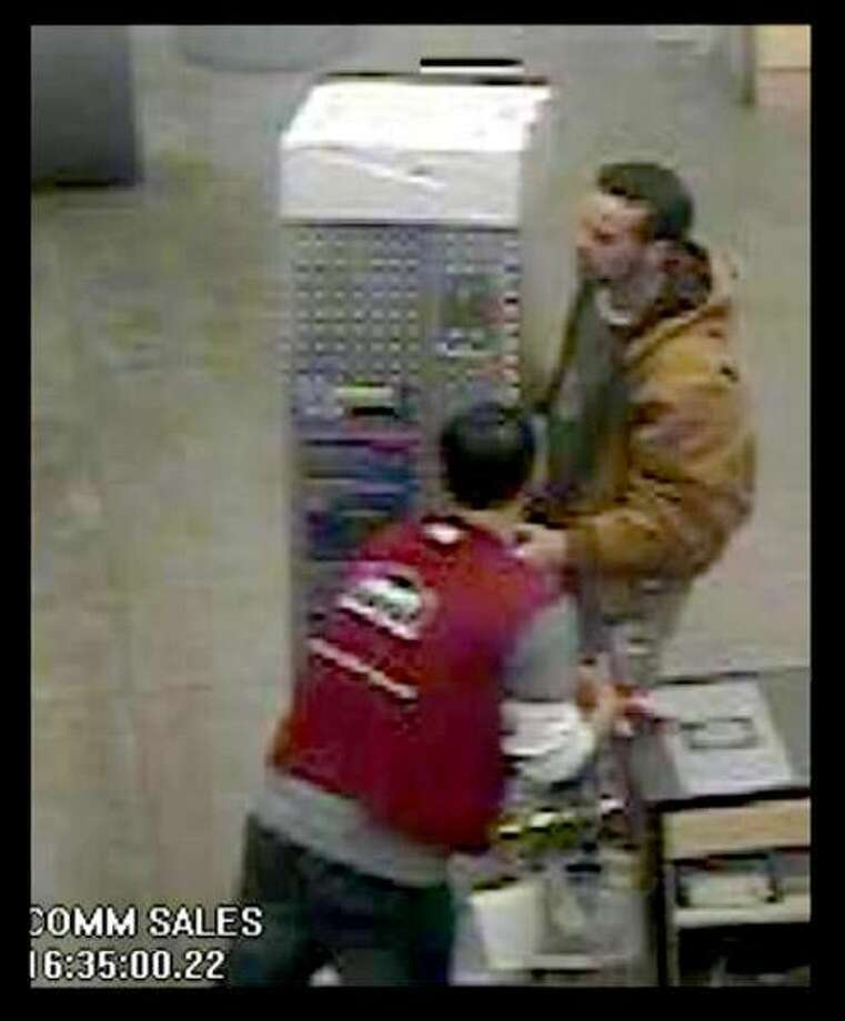 In photo 1 the male is seen leaving the store with a silver pickup truck bed tool box.