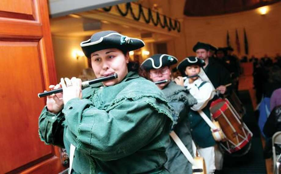 Photo by Arnold Gold Jessica Figueroa (left) leads the Milford Volunteer Ancient Fife and Drum Corp during the kickoff of Milford 375th birthday celebration at City Hall on Jan. 6.