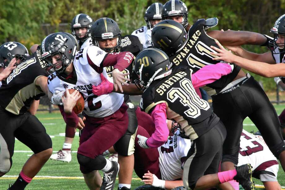 Torrington's Conrad Avallone runs the ball against Waterbury Career Academy at Municipal Stadium on Thursday. Photo: Pete Paguaga / Hearst Connecticut Media / Connecticut Post