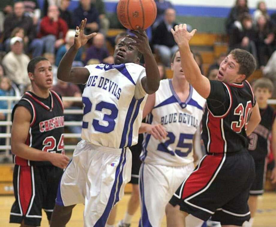 Photo by Russ McCreven West Haven's Kadialy Toure (23) scrambles for a loose ball with Cheshire's Billy Weyrauch.