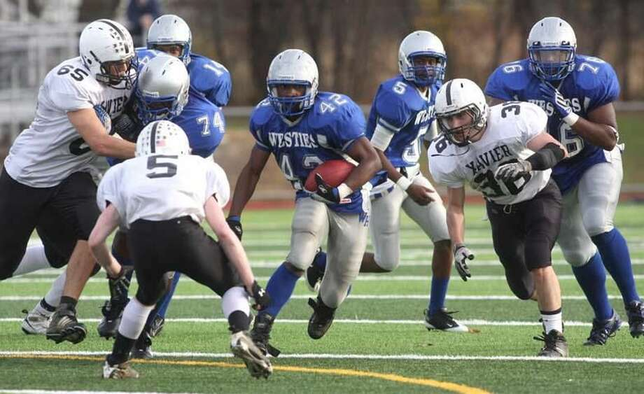 West Haven's Devante Credle looks for room to run against Xavier. (Photo by Russ McCreven)
