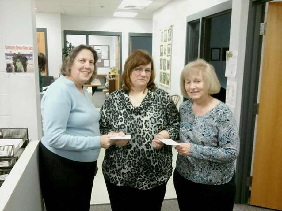Submitted Photo Susan D'Orso, left, and Maureen Boian, right, of OCW presenting the gift cards to Kim Callahan, center, of Orange Community Services department.