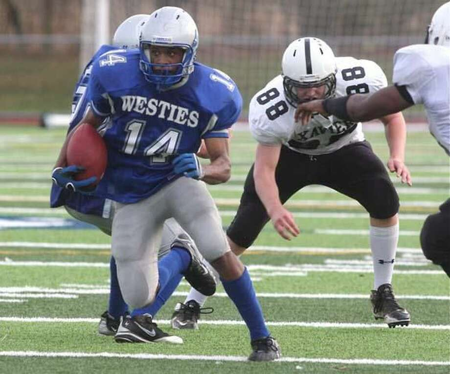 West Haven's Marquies Highsmith runs through the Xavier defense in the Westies' 28-0 loss. (Photo by Russ McCreven)