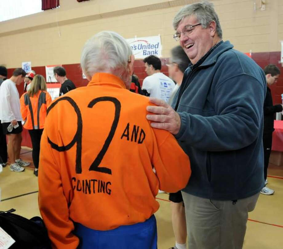 Photos by Mara Lavitt - Orange First Selectman Jim Zeoli congratulates former Orange resident George Whitney on finishing the race. Whitney is 92 years young.