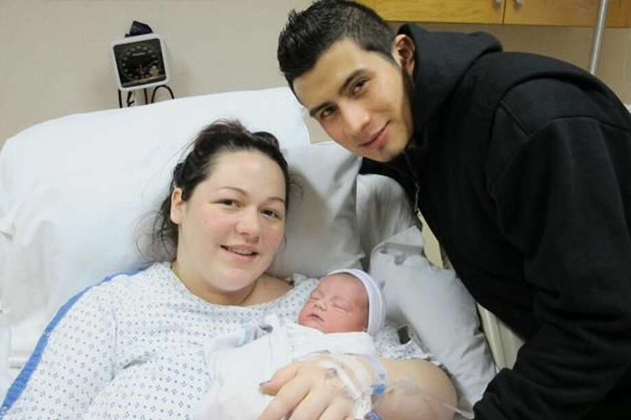 Submitted Photo New parents Karena Bennett and Elder Marroquin cradle their newborn, born Friday, Jan. 2, at Milford Hospital.