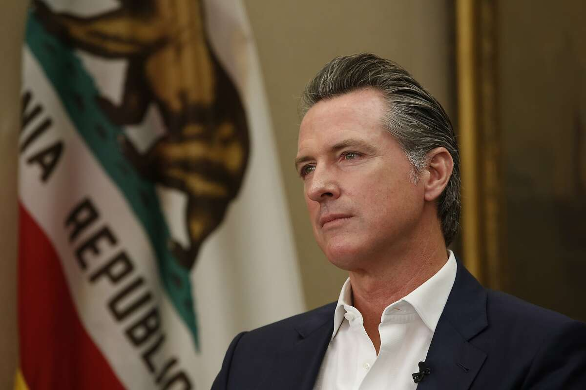 California Gov. Gavin Newsom listens to a question during an interview in Sacramento, Calif., Tuesday, Oct. 8, 2019. Newsom said President Donald Trump should be removed from office by Congress, but with Republicans in control of the U.S. Senate the best way to boot Trump from office is at the ballot box. (AP Photo/Rich Pedroncelli)