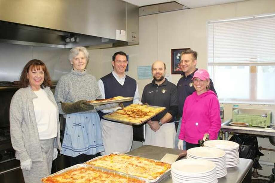 Submitted Photo Milford Superintendent of Schools Elizabeth Feser and Mayor Benjamin G. Blake, center holding trays, joined Devon Rotarians, left to right, Priscilla Lynn, Greyson Schwing, Howard Sadinski, and Erika Shea, at Beth-El Center's soup kitchen.