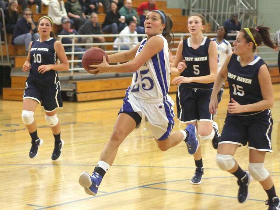 Photo by Russ McCreven West Haven's McKenzie Farquharson heads to the basket in the Westies' 63-52 win over East Haven.