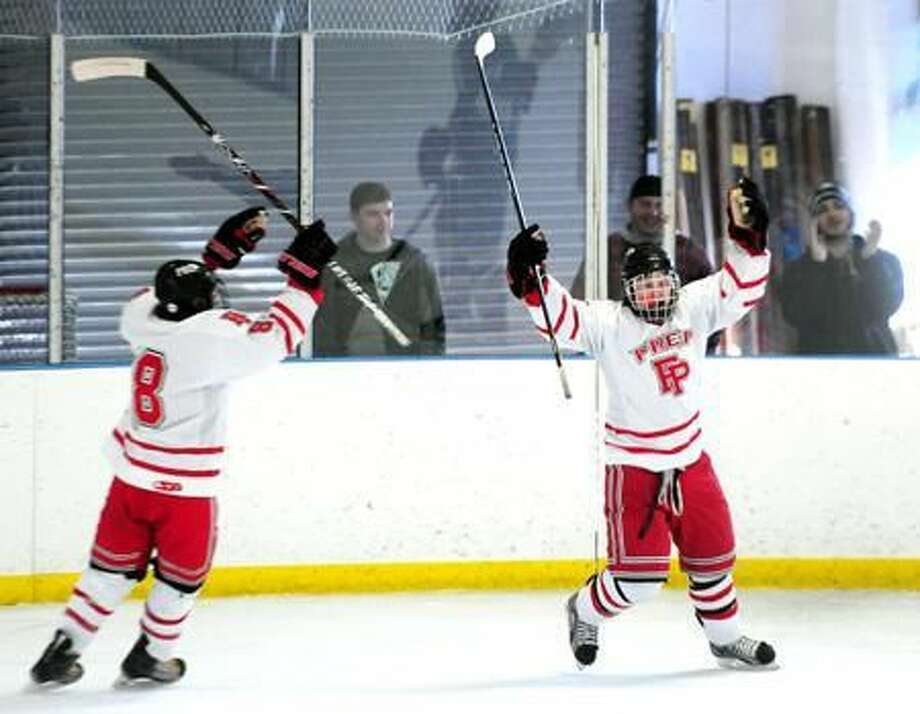 David White (left) and Connor Henry (right) of Fairfield Prep celebrate their first score against Notre Dame of West Haven at the Wonderland of Ice in Bridgeport on 1/7/2012. Henry scored the goal. Photo by Arnold Gold/New Haven Register