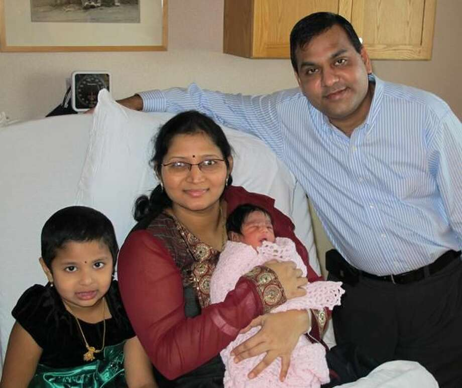 Submitted Photo The Kurra/Vemineni Family of Milford welcomed Milford's first baby of 2012. Pictured left to right are Priyanka Kurra, 4; Srilakshmi Vemineni holding newborn Aiswarya Kurra; and Kishor Kurra.