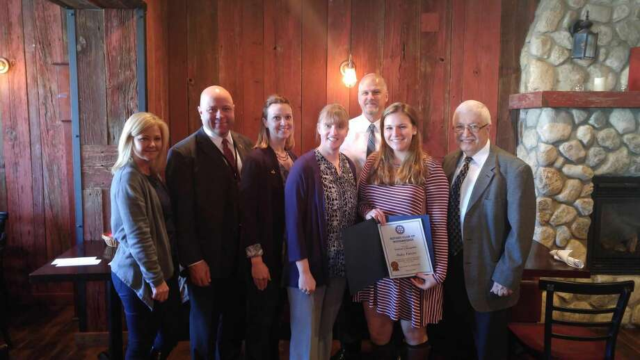 CONTRIBUTED PHOTO From left, Donna Warecke, owner, manager of the Woodbridge Social Restaurant, which has partnered with the Rotary Club for the Amity monthly award; Charles Dumais, superintendent of Amity Region 5 School District; Jill LaPlante, head of the Amity High School Counseling Department; Marian Boyns, school counselor; Charles Forcier, Haley Forcier's father, in the rear; Student of the Month Haley Forcier; and Rotarian Guy Stella, superintendent of school of the Woodbridge school district.