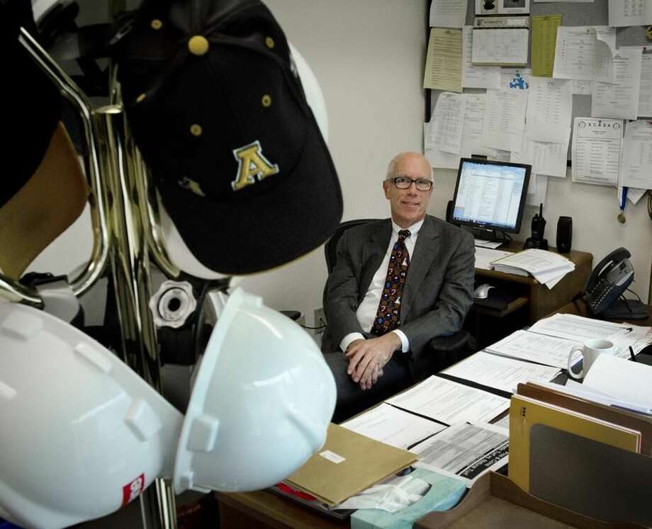John Brady has worn many hats as Amity Superintendent of school,but he's hanging them all up. Brody is retiring. Melanie Stengel/Register