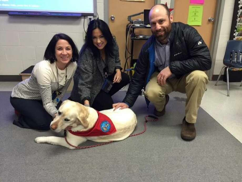 SUBMITTED PHOTO From left, Analisa Sherman, Beecher Road School assistant principal; Teresa Nakouzi, language arts specialist; and Ethan Marin, a parent and the owner of therapy dog.
