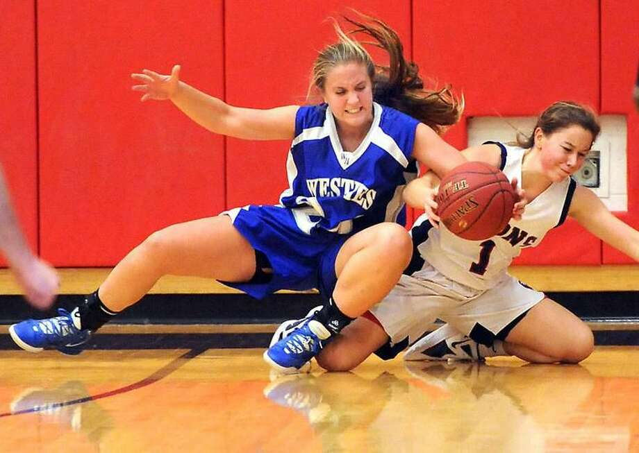 West Haven at Foran in Milford girls basketball, Foran won 34-33. West Haven's Ava Gambardella and Foran's Rebekah DeRosa. Mara Lavitt/New Haven Register1/2/13