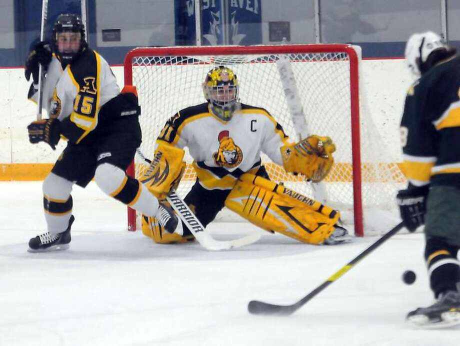 Trinity Catholic at Amity, boys hockey, Bennett Rink, West Haven. Amity's John Uscilla and goalie Nick Nuzzolo. Mara Lavitt/New Haven Register1/3/13