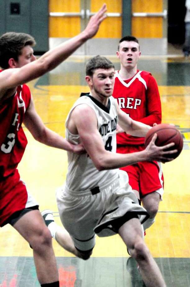 Joseph Bongiorni (right) of Notre Dame of West Haven drives past Tim Butala (left) of Fairfield Prep on 1/4/2013.Photo by Arnold Gold/New Haven Register AG0479A